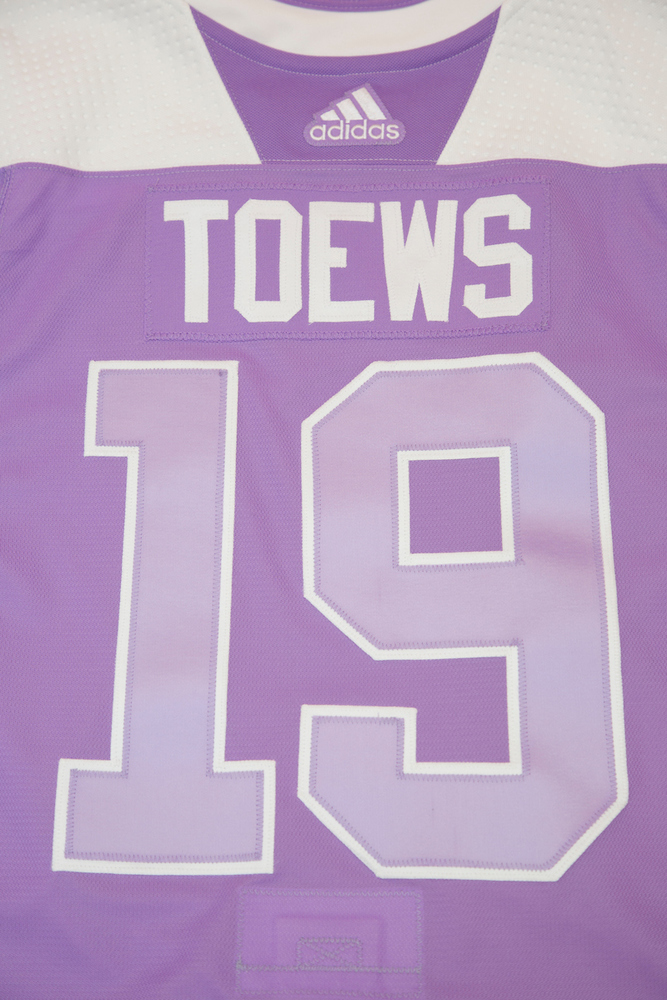3c13469ca75 #19-Autographed Authentic Hockey Fights Cancer Warmup Jersey - Chicago  Blackhawks