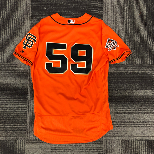 Photo of San Francisco Giants - 2018 Game Used Orange Home Alternate Jersey & Orange Bill Cap Worn by #56 Andrew Suarez - Jersey was worn on 8/31/18 vs. New York Mets - 7.0 IP, 5 K's, WIN (Career Win #6) - Jersey Size 46 & Cap Size 7 1/4