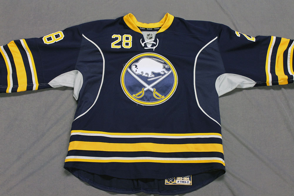 Zemgus Girgensons Game Worn Buffalo Sabres Home Jersey.  Serial: 1183-2. Set 2 - Size 56.  2013-14 season.