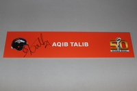NFL - BRONCOS AQIB TALIB SIGNED SB50 LOCKER ROOM SIGN