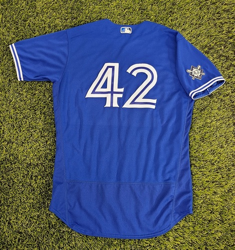 Photo of CHARITY AUCTION: Authenticated Team Issued #42 Jersey: Jordan Romano (2020 Season). Size 46.