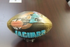 Jaguars Customized Artist Football Autographed by Collin Johnson - Jags player making a diving play depicted in artwork