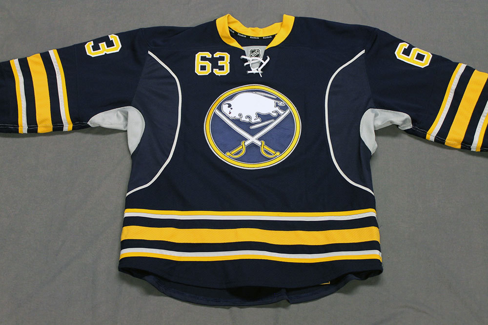 Tyler Ennis Game Worn Buffalo Sabres Home Jersey.  Serial: 1176-2. Set 2 - Size 54.  2013-14 season.