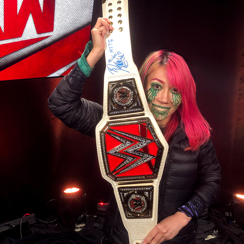 Photo of Asuka SIGNED WWE RAW Women's Championship Replica Title