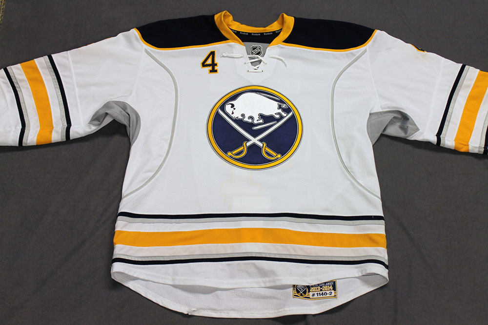 Jamie McBain Game Worn Buffalo Sabres Away Jersey.  Serial: 1140-2. Set 2 - Size 56.  2013-14 season.