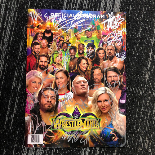 Photo of WrestleMania 34 SIGNED Program (20 Superstars)