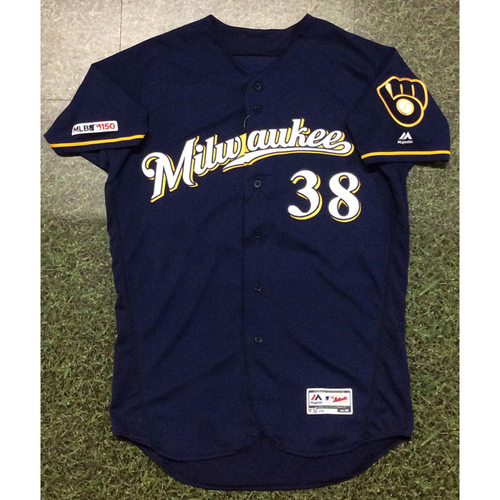 Photo of Devin Williams 2019 Game-Used Navy Ball & Glove Jersey
