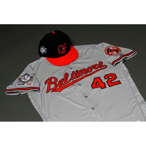 Photo of Arnie Beyeler Autographed, Game-Worn Jackie Robinson Day Jersey and Cap