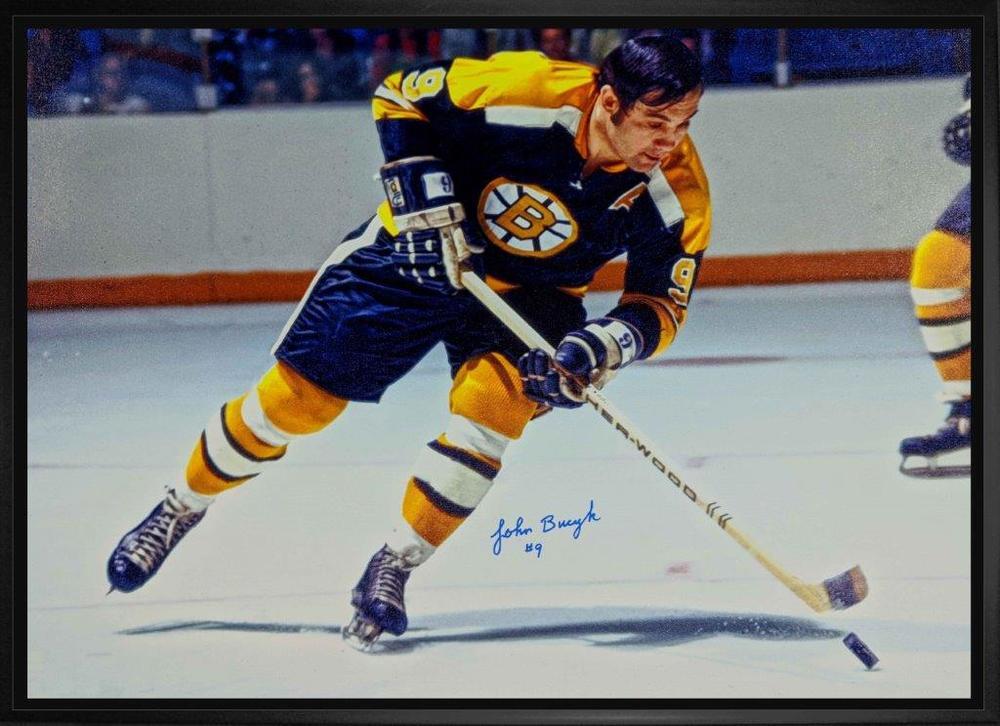 Johny Bucyk Signed 20x29 Canvas Framed Bruins Black-H Skating w/Puck