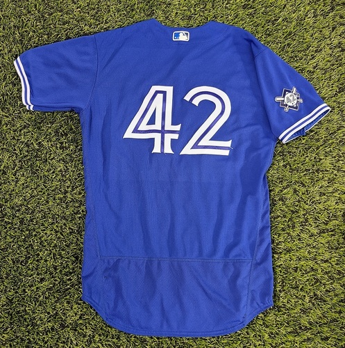 Photo of CHARITY AUCTION: Authenticated Game Used #42 Jersey: Lourdes Gurriel Jr. (Aug 28, 20: 0-for-4). Size 44.