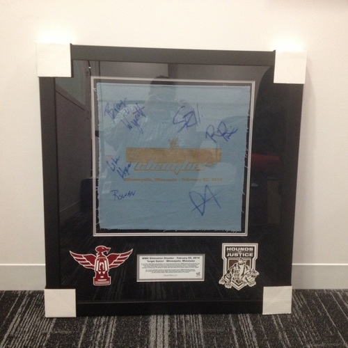 The Shield vs. The Wyatt Family Framed & Signed piece of used ring canvas