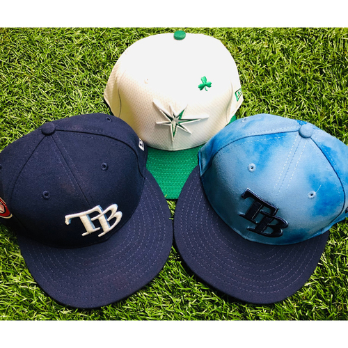 Photo of National Keratoconus Foundation: Tommy Pham - Team Issued St. Patrick's Day Cap, Team-Issued Memorial Day Cap and Game-Used Father's Day Cap