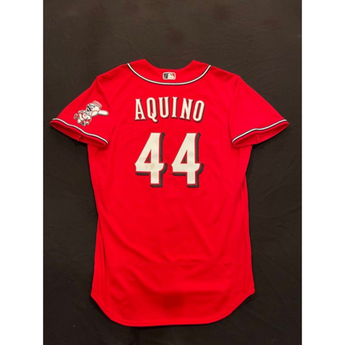 Photo of Aristides Aquino -- 2021 Los Rojos Jersey -- Game Used from Sept 24 (Defensive Replacement at LF: Went 2-for-2, RBI) -- Recorded First Career Walk-Off Hit in the 11th Inning -- Size: 46
