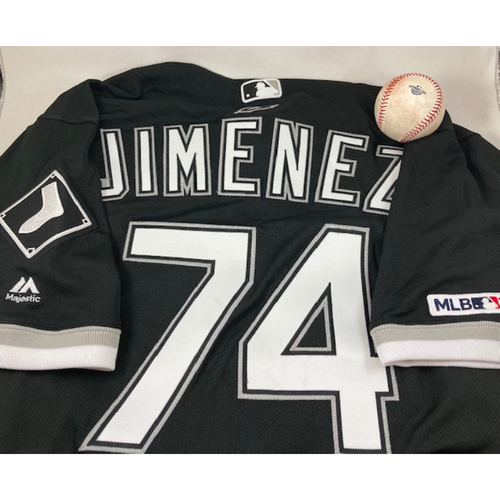 Photo of The 2019 Rookie Package - Game-Used Baseball from March 28, 2019 - Eloy Jimenez MLB Debut and an Eloy Jimenez 2019 Game-Used Black Alternate Jersey