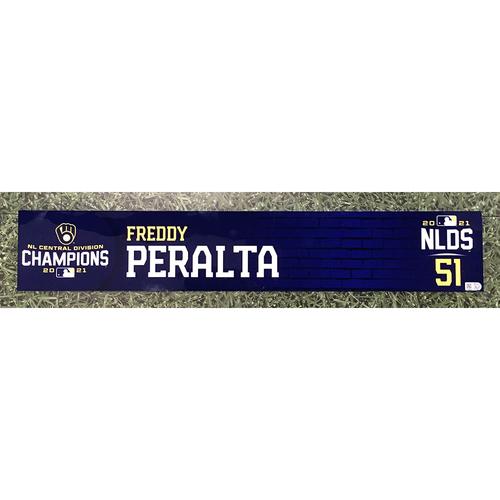 Photo of Freddy Peralta 2021 Game-Used NLDS Locker Nameplate