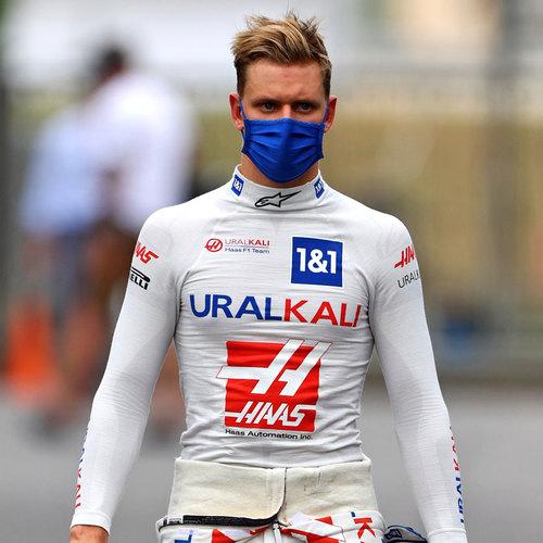 Photo of Mick Schumacher 2021 Signed Race Used Nomex - Italian GP