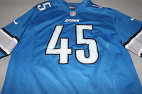 LIONS - CHARLES WASHINGTON SIGNED LIONS REPLICA JERSEY - SIZE L (STAIN ON FRONT OF JERSEY)