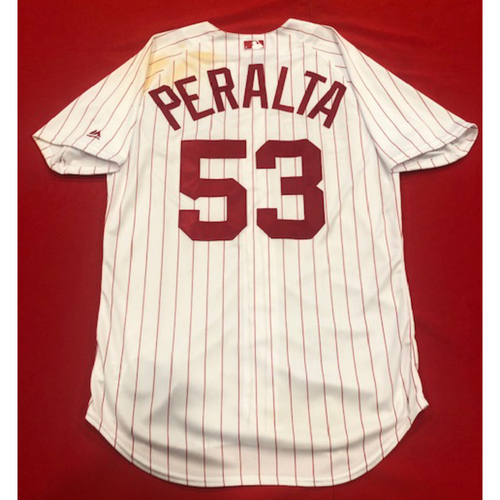 Photo of Wandy Peralta -- 1967 Throwback Jersey -- Game-Used for Rockies vs. Reds on July 28, 2019 -- Jersey Size: 46