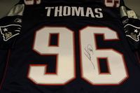 PATRIOTS - ADALIUS THOMAS SIGNED AUTHENTIC PATRIOTS REEBOK JERSEY - SIZE 54 (STAINS ON JERSEY NUMBERS)