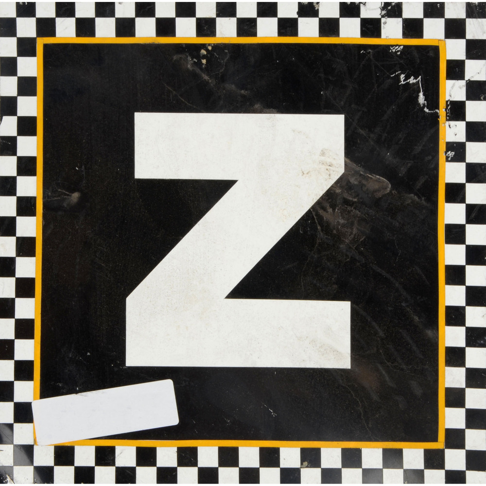 Daytona International Speedway Black with Checkerd Trim Letter Z 12