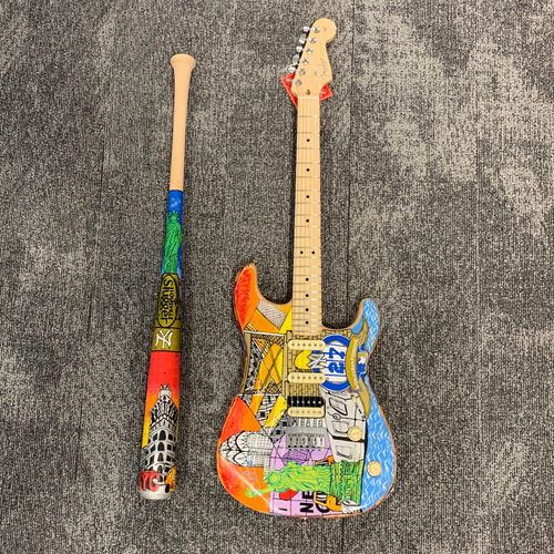 One-of-a-kind Didi Gregorius Painted Yankees Louisville Slugger Bat and Fender Stratocaster Guitar