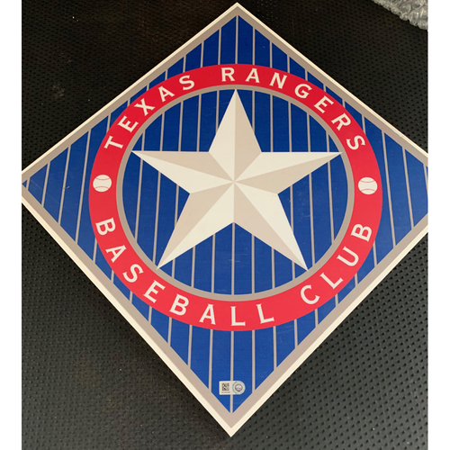 Photo of Texas Rangers 1994 Vintage Logo Sign Displayed in Tunnel Leading From Home Clubhouse to Home Dugout at Globe Life Park