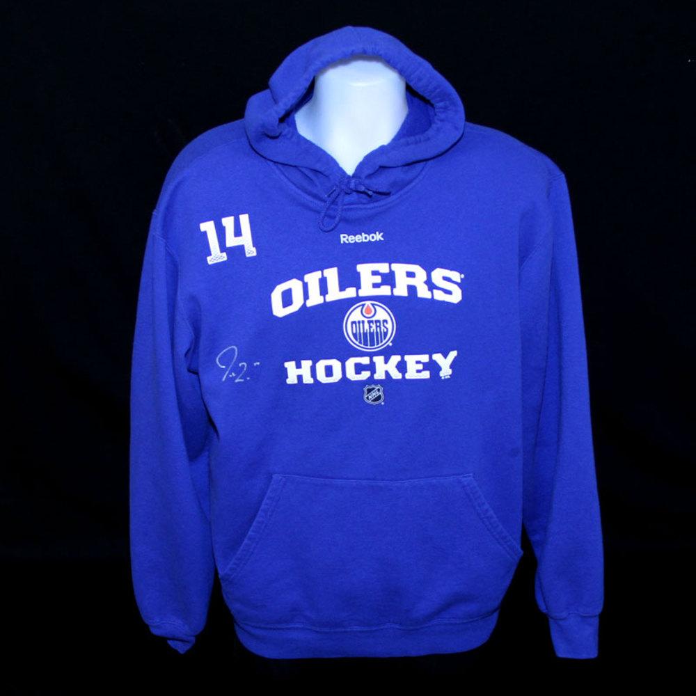 Jordan Eberle #14 - Autographed 2013-14 Edmonton Oilers Team Issued And Worn Royal Blue Hoodie