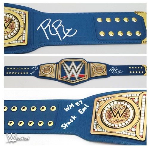 Photo of Roman Reigns SIGNED Universal Championship Blue Replica Title
