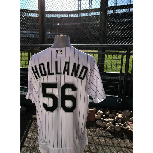 Photo of 2017 National League Comeback Player of the Year Award Winner Greg Holland Game-Used Jersey 500th Career Strikeout.