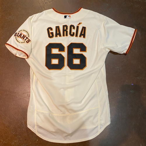 Photo of 2021 Game Used Home Cream Jersey worn by #66 Jarlin Garcia on 4/9 vs. COL - Home Opening Day, 4/10 vs. COL, & 4/12 vs. CIN - 2.1 IP, 3 K's - Size 46