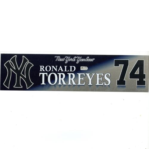 Photo of Ronald Torreyes New York Yankees 2017 Game-Used #74 Locker Room Nameplate (6/25/2017)
