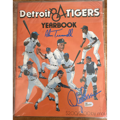 Photo of Detroit Tigers 1984 Yearbook Autographed By Alan Trammell and Lance Parrish (MLB AUTHENTICATED)