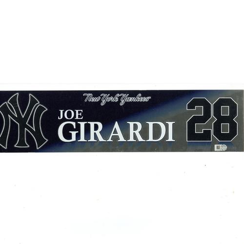 Photo of Joe Girardi New York Yankees 2017 Game-Used #28 Locker Room Nameplate (9/27/2017)