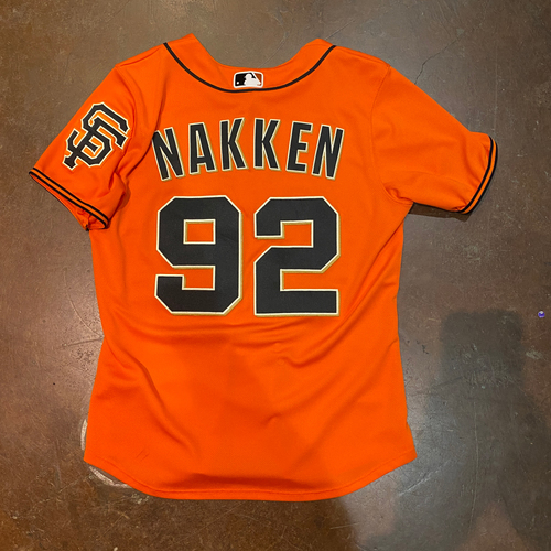 Photo of 2021 Game Used Orange Home Alt Jersey worn by #92 Alyssa Nakken on Game Used on 6/4 vs. CHC - Size W-L