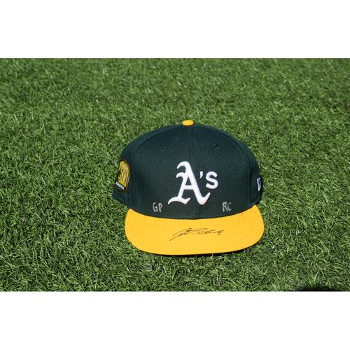 Photo of Oakland Athletics Game Used Autographed Jake Smolinski 50th Anniversary Cap