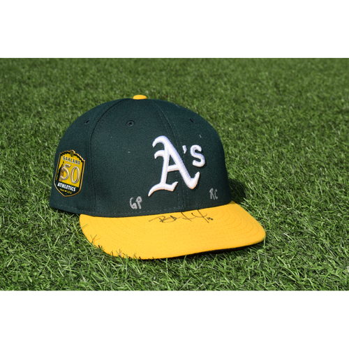 Photo of Oakland Athletics Game Used Autographed Bruce Maxwell 50th Anniversary Cap
