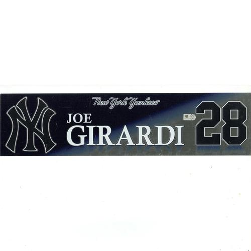 Photo of Joe Girardi New York Yankees 2017 Game-Used #28 Locker Room Nameplate (9/28/2017)