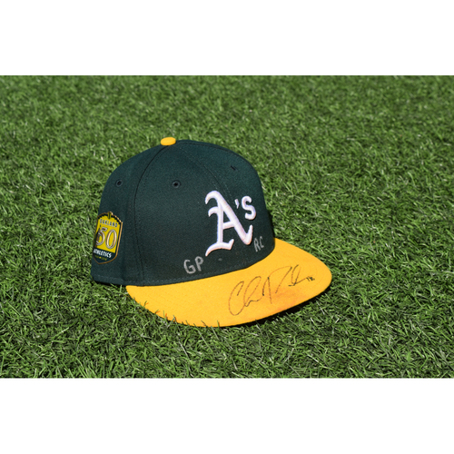 Photo of Oakland Athletics Game Used Autographed Chad Pinder 50th Anniversary Cap