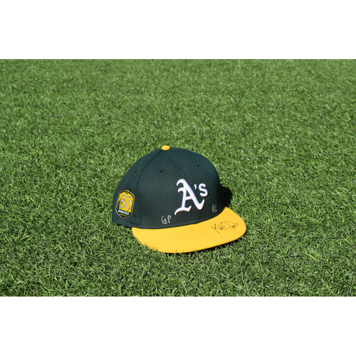 Photo of Oakland Athletics Game Used Autographed Khris Davis 50th Anniversary Cap