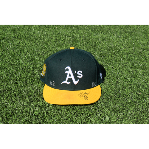 Photo of Oakland Athletics Game Used Autographed Yusmeiro Petit 50th Anniversary Cap