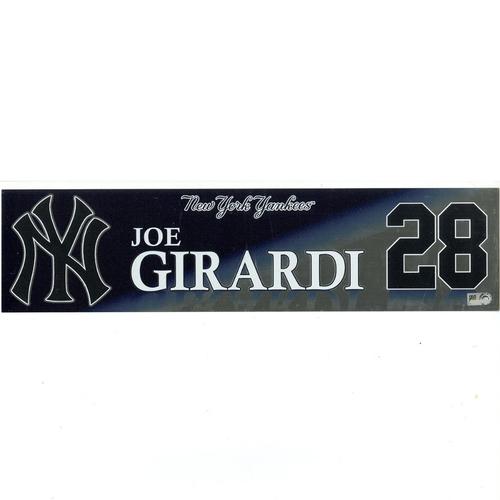 Photo of Joe Girardi New York Yankees 2017 Game-Used #28 Locker Room Nameplate (9/30/2017)