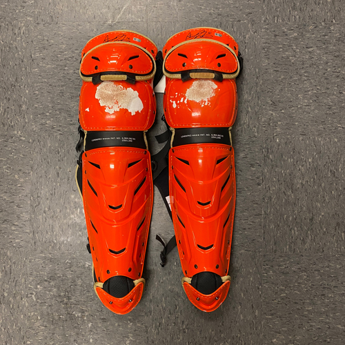 Photo of #16 Aramis Garcia Team Issued Autographed Orange Shin Guards