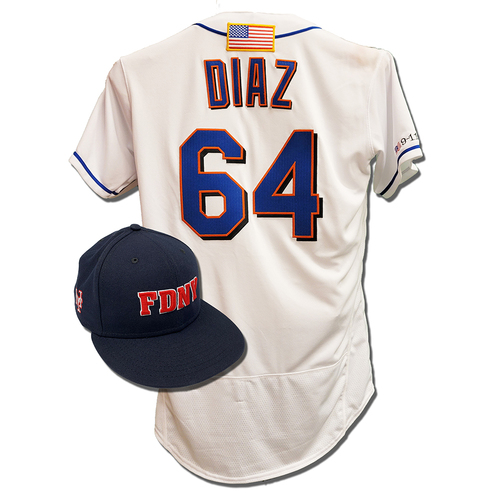 Photo of Yennsy Diaz #64 - Game Used First Responder Hat and Game Used White Commemorative Jersey with American Flag Patch - Mets vs. Yankees - 9/11/2021