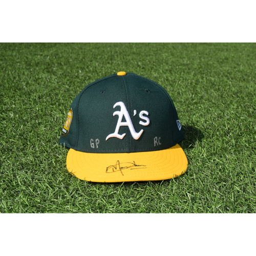 Photo of Oakland Athletics Game Used Autographed Marcus Jensen 50th Anniversary Cap