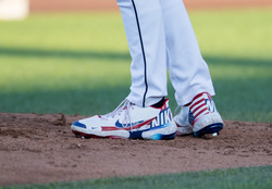 Photo of George Kirby Autographed July 4th Cleats