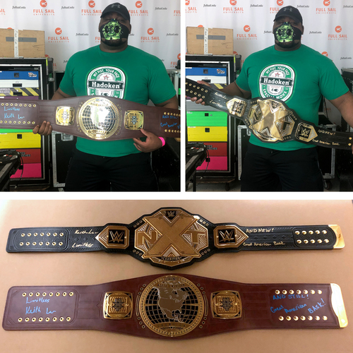 Photo of Keith Lee SIGNED North American AND NXT Championship Replica Titles