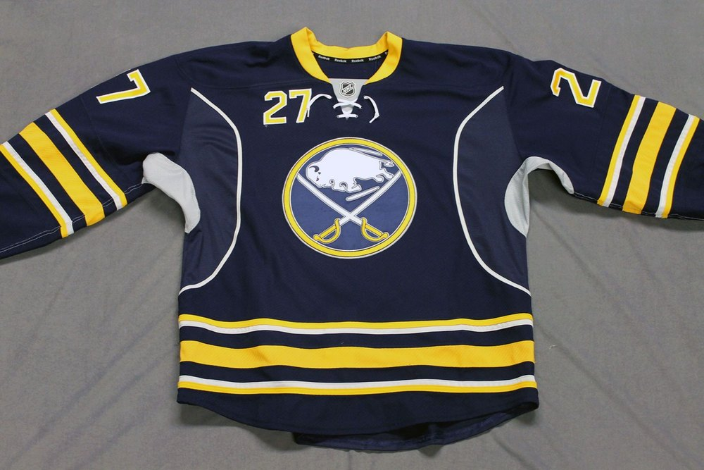 Matt D'Agostini Game Worn Buffalo Sabres Home Jersey.  Serial: 1055-1. Set 2 - Size 56.  2013-14 season.