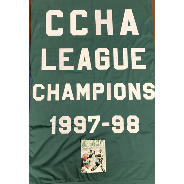 Photo of 1997-98 CCHA Champions Banner and Autographed Media Guide