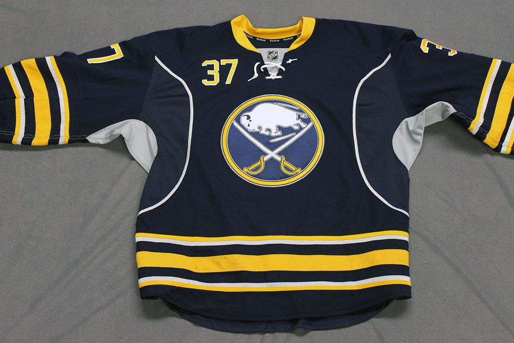 Matt Ellis Game Worn Buffalo Sabres Home Jersey.  Serial: 1056-1. Set 2 - Size 56.  2013-14 season.