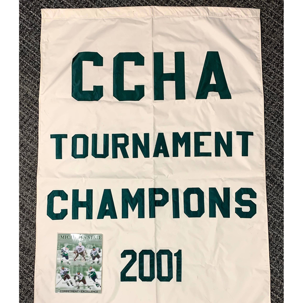 Photo of 2000-01 CCHA Tournament Champions Banner and Autographed Media Guide